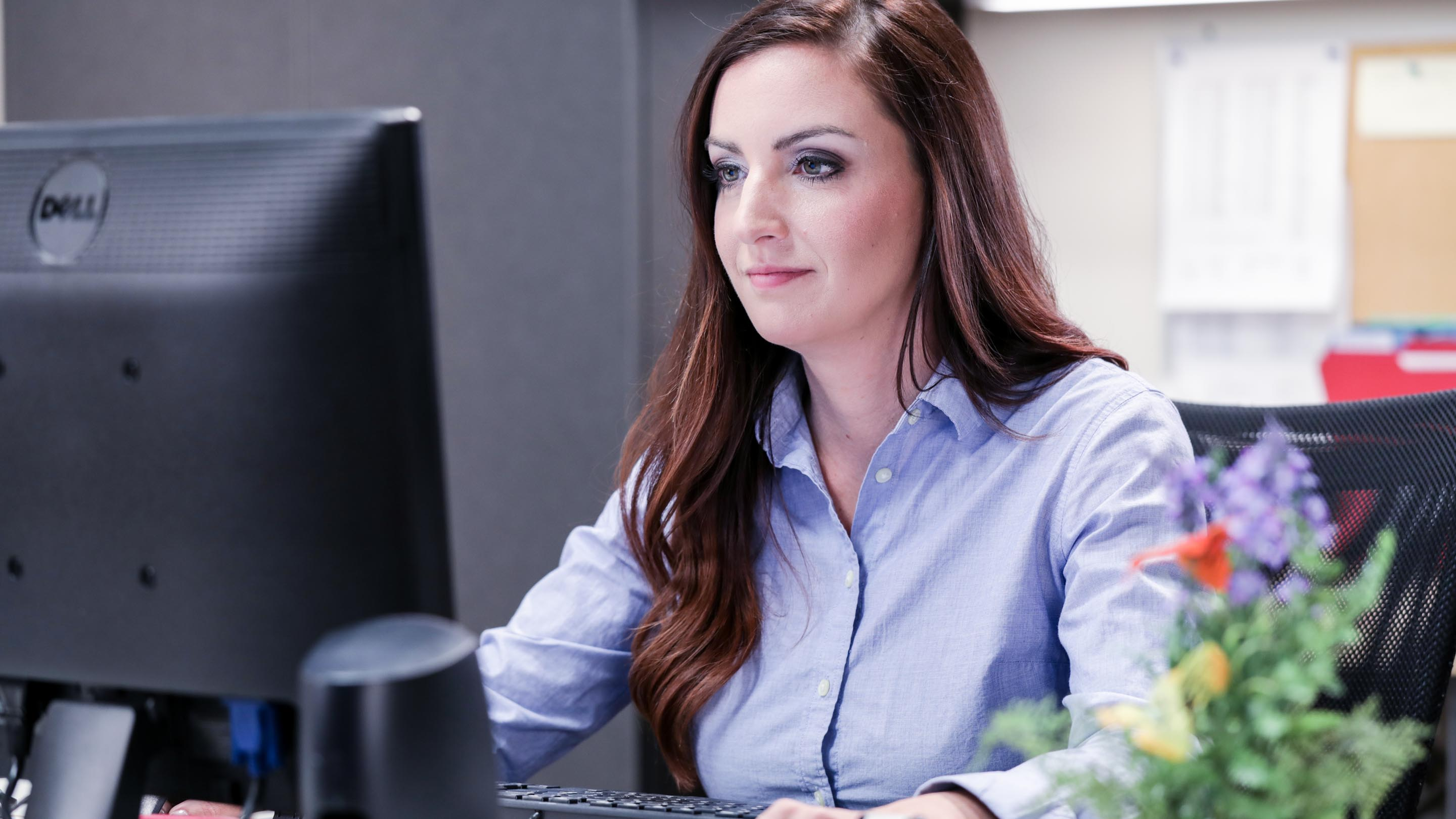 Customer support woman at computer