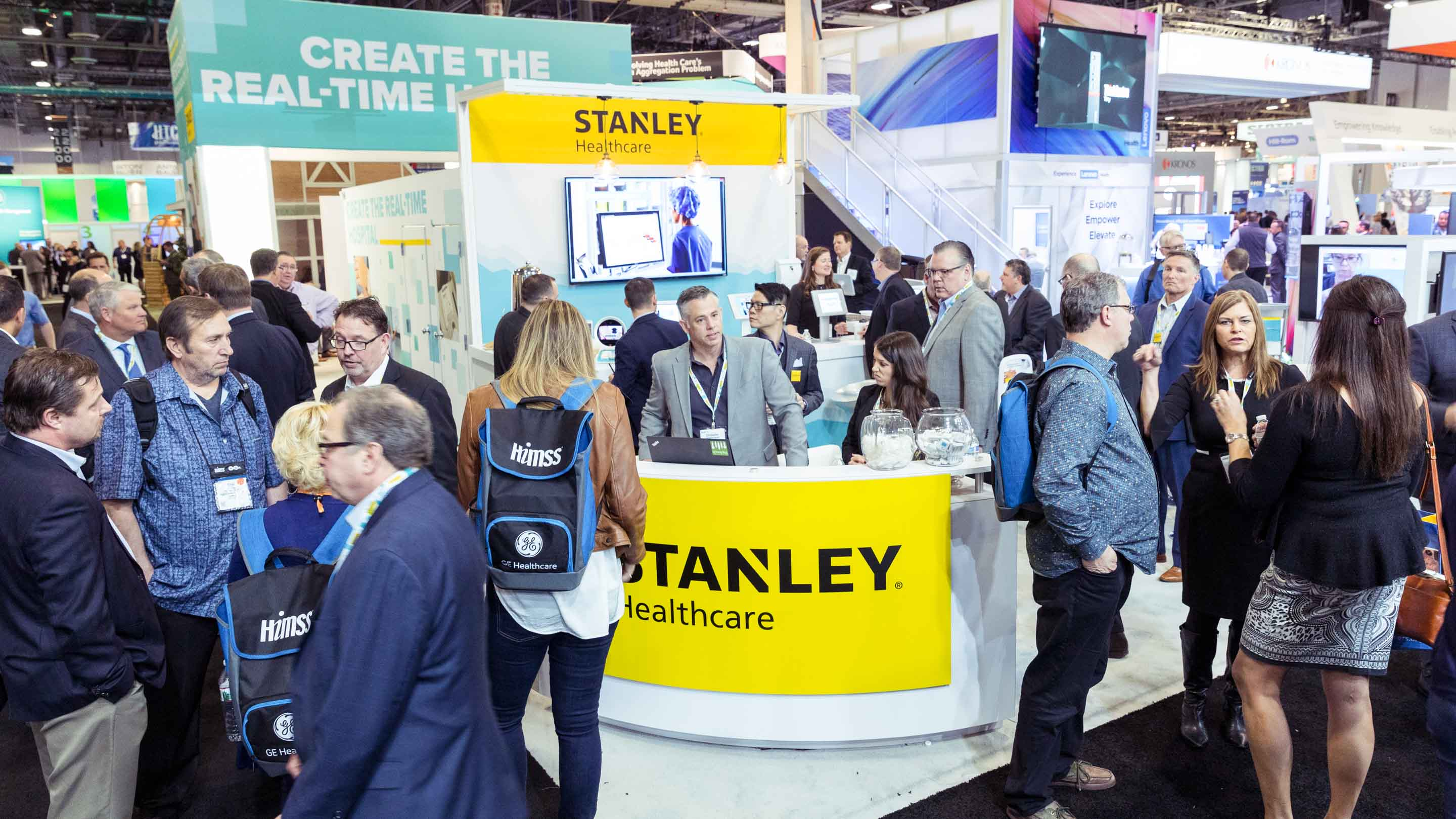 STANLEY Healthcare event booth with crowd of people