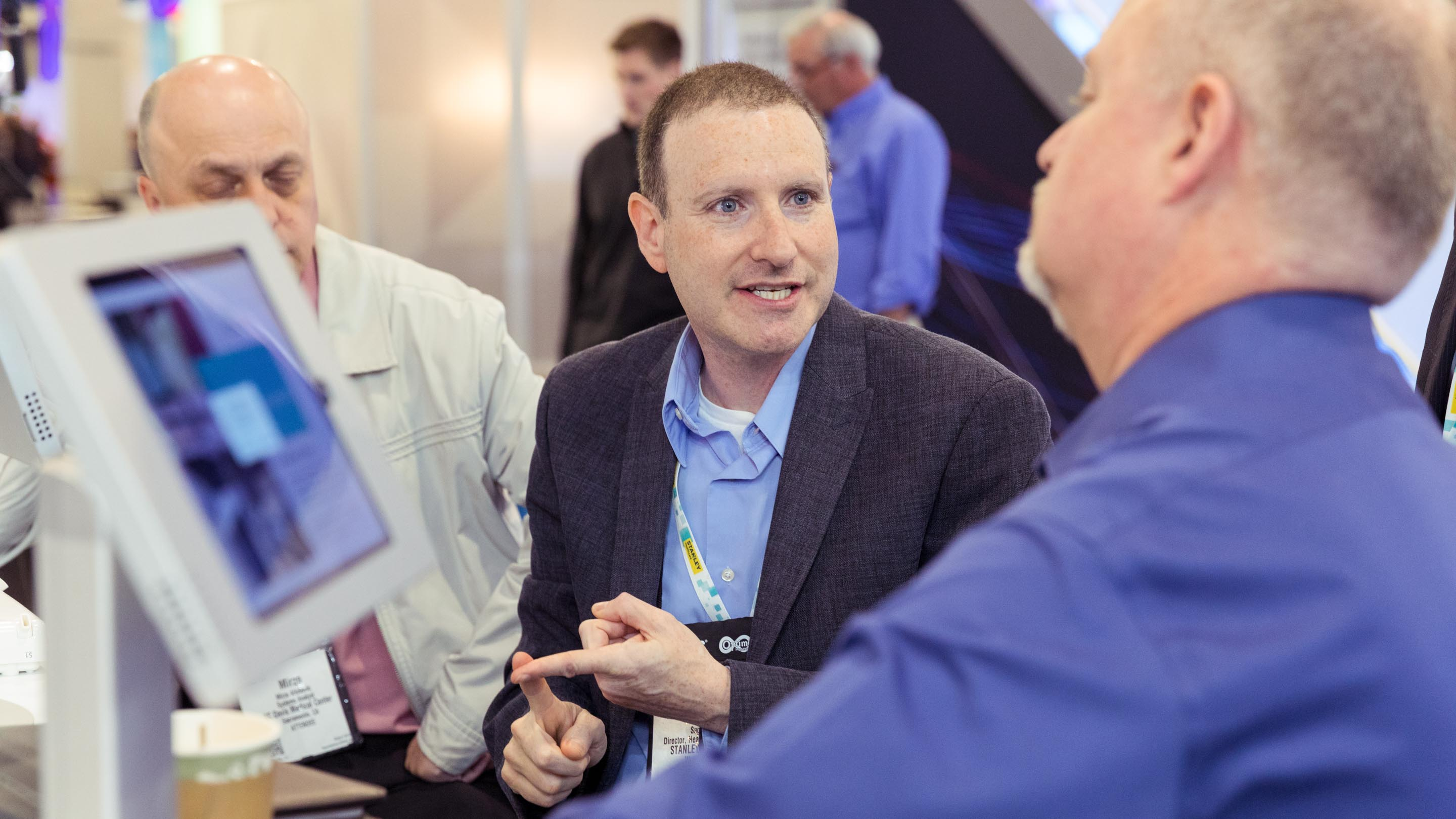 Man speaks to another at STANLEY Healthcare event